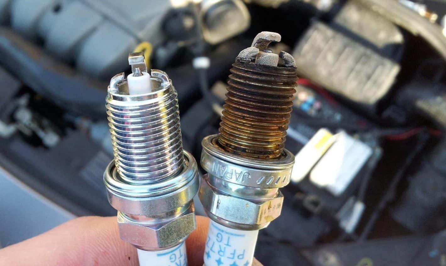 the new spark plug and the damaged spark plug